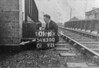 SD650001K, Man marking Ordnance Survey minor control revision point with an arrow in 1940s
