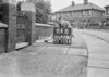 SD640264B, Man marking Ordnance Survey minor control revision point with an arrow in 1940s