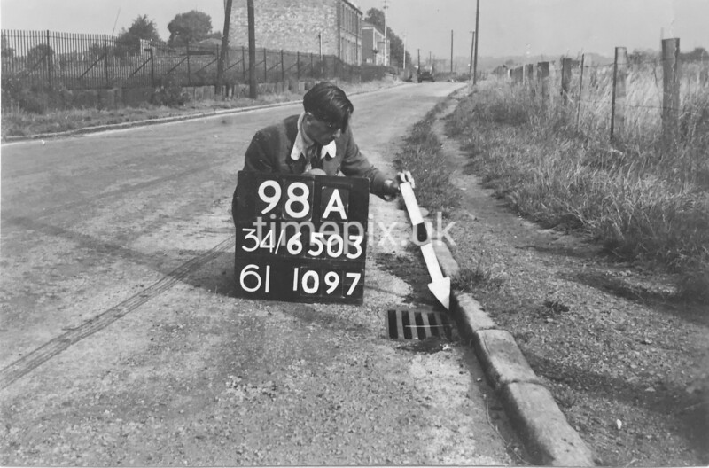 SD650398A, Man marking Ordnance Survey minor control revision point with an arrow in 1940s