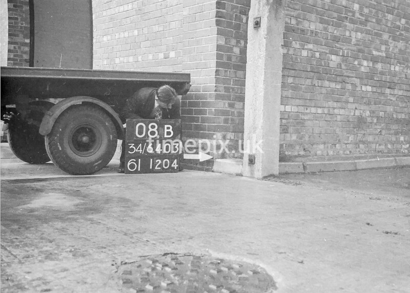 SD640308B, Man marking Ordnance Survey minor control revision point with an arrow in 1940s