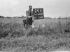 SD640224A, Man marking Ordnance Survey minor control revision point with an arrow in 1940s