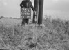 SD630175A, Man marking Ordnance Survey minor control revision point with an arrow in 1940s