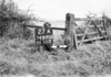 SD630327A, Man marking Ordnance Survey minor control revision point with an arrow in 1940s