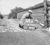 SD620268A, Man marking Ordnance Survey minor control revision point with an arrow in 1950s