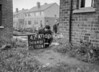 SD640147A, Man marking Ordnance Survey minor control revision point with an arrow in 1940s