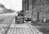 SD630315A, Man marking Ordnance Survey minor control revision point with an arrow in 1940s