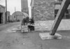 SD630133A, Man marking Ordnance Survey minor control revision point with an arrow in 1950s