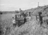 SD640393A, Man marking Ordnance Survey minor control revision point with an arrow in 1940s