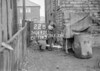 SD640122B, Man marking Ordnance Survey minor control revision point with an arrow in 1940s