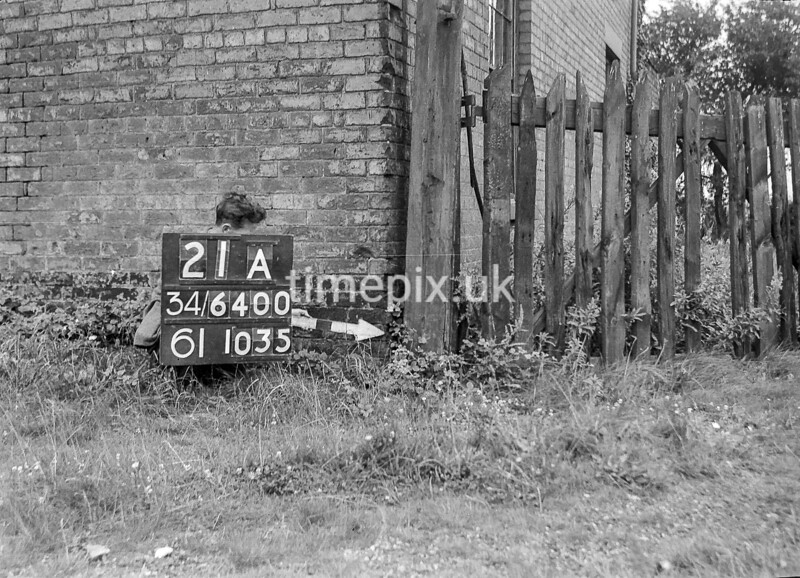 SD640021A, Man marking Ordnance Survey minor control revision point with an arrow in 1940s