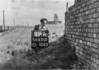 SD650189A, Man marking Ordnance Survey minor control revision point with an arrow in 1940s