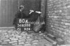 SD650080K, Man marking Ordnance Survey minor control revision point with an arrow in 1940s