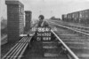 SD650286A, Man marking Ordnance Survey minor control revision point with an arrow in 1940s