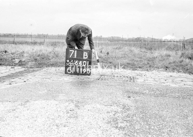 SD640171B, Man marking Ordnance Survey minor control revision point with an arrow in 1940s