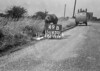 SD630149B, Man marking Ordnance Survey minor control revision point with an arrow in 1940s