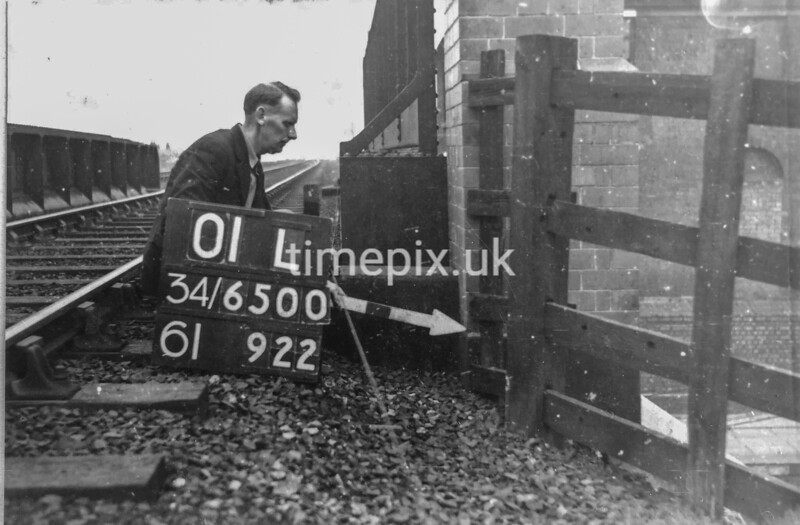 SD650001L, Man marking Ordnance Survey minor control revision point with an arrow in 1940s