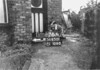 SD650176A, Man marking Ordnance Survey minor control revision point with an arrow in 1940s
