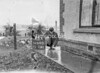 SD640145A, Man marking Ordnance Survey minor control revision point with an arrow in 1940s