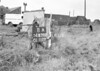 SD630311A, Man marking Ordnance Survey minor control revision point with an arrow in 1940s
