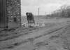 SD630124A, Man marking Ordnance Survey minor control revision point with an arrow in 1950s