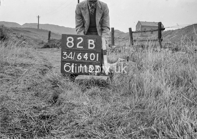 SD640182B, Man marking Ordnance Survey minor control revision point with an arrow in 1940s