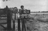 SD650210A, Man marking Ordnance Survey minor control revision point with an arrow in 1940s
