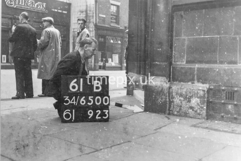 SD650061B, Man marking Ordnance Survey minor control revision point with an arrow in 1940s