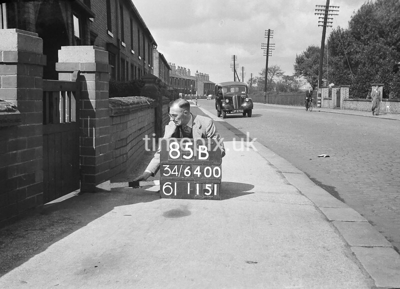 SD640085B, Man marking Ordnance Survey minor control revision point with an arrow in 1940s