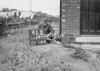 SD640141B, Man marking Ordnance Survey minor control revision point with an arrow in 1940s