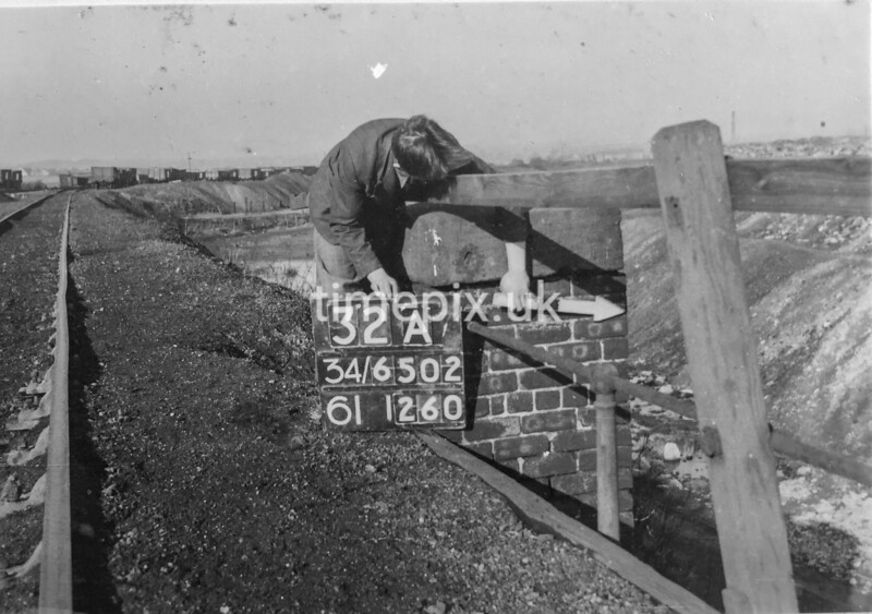 SD650232A, Man marking Ordnance Survey minor control revision point with an arrow in 1940s