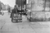 SD650080B, Man marking Ordnance Survey minor control revision point with an arrow in 1940s