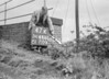 SD640247K, Man marking Ordnance Survey minor control revision point with an arrow in 1940s