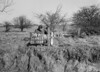 SD640336A, Man marking Ordnance Survey minor control revision point with an arrow in 1940s