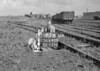 SD640097B, Man marking Ordnance Survey minor control revision point with an arrow in 1940s