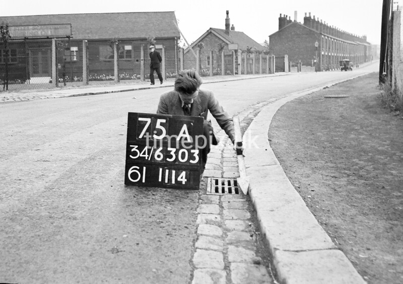 SD630375A, Man marking Ordnance Survey minor control revision point with an arrow in 1940s