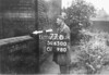 SD650077B, Man marking Ordnance Survey minor control revision point with an arrow in 1940s