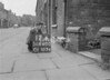 SD640012A, Man marking Ordnance Survey minor control revision point with an arrow in 1940s