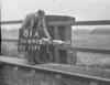 SD640281A, Man marking Ordnance Survey minor control revision point with an arrow in 1940s