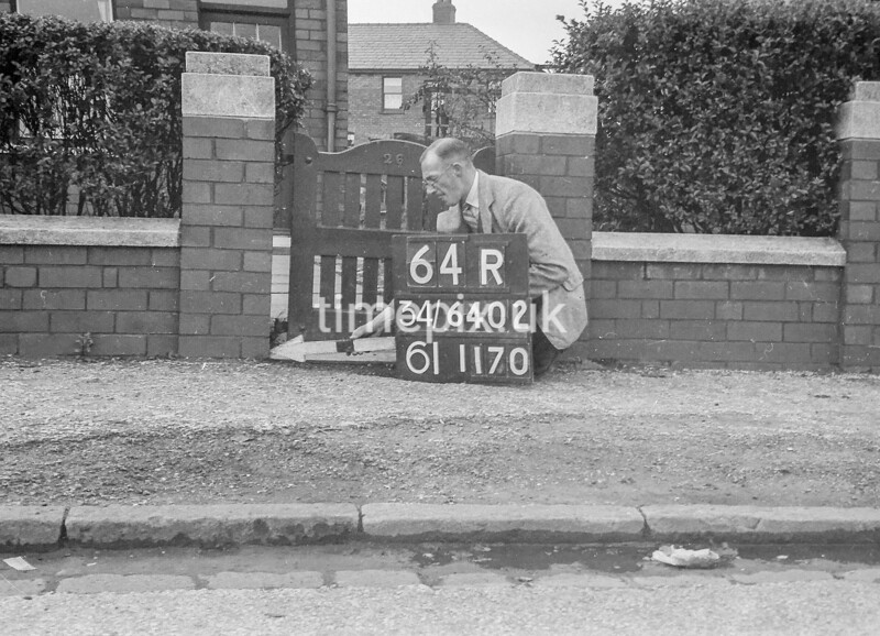 SD640264R, Man marking Ordnance Survey minor control revision point with an arrow in 1940s