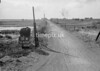 SD630151A, Man marking Ordnance Survey minor control revision point with an arrow in 1940s