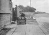 SD640319A, Man marking Ordnance Survey minor control revision point with an arrow in 1940s