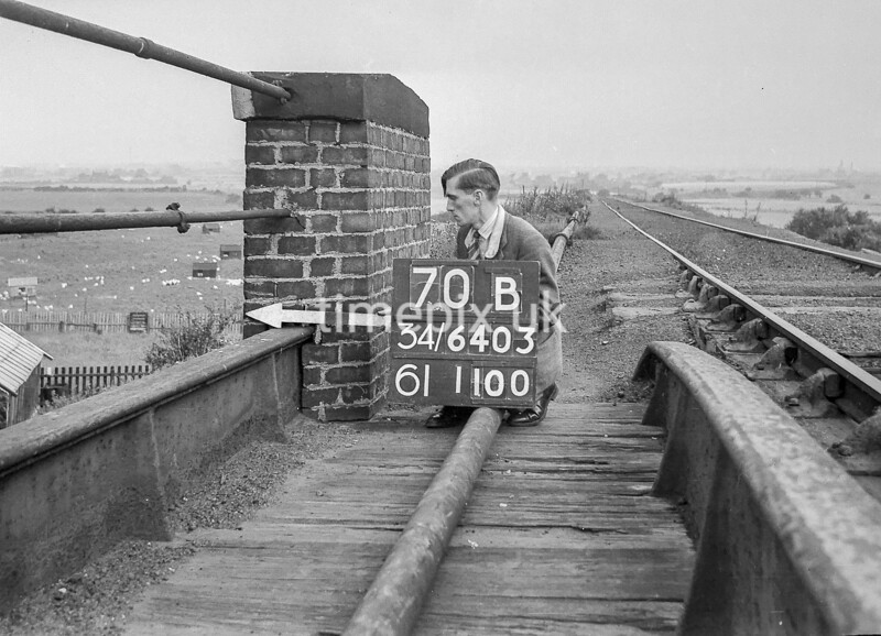 SD640370B, Man marking Ordnance Survey minor control revision point with an arrow in 1940s