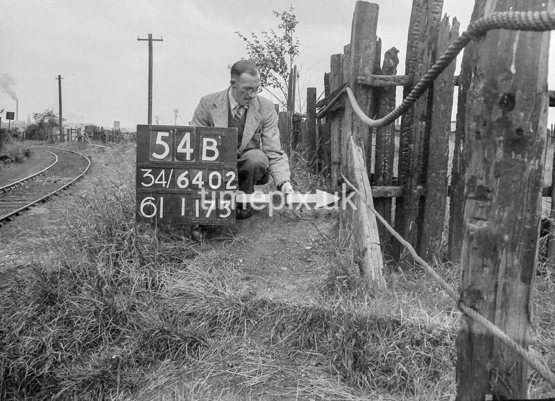 SD640254B, Man marking Ordnance Survey minor control revision point with an arrow in 1940s