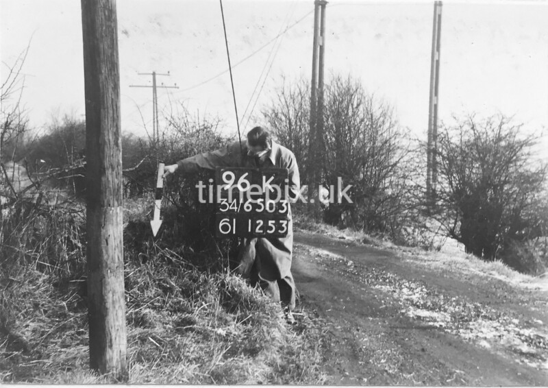 SD650396K, Man marking Ordnance Survey minor control revision point with an arrow in 1940s