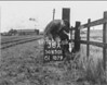 SD650138A, Man marking Ordnance Survey minor control revision point with an arrow in 1940s