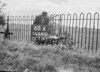 SD640168A, Man marking Ordnance Survey minor control revision point with an arrow in 1940s
