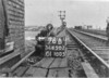 SD650276B, Man marking Ordnance Survey minor control revision point with an arrow in 1940s