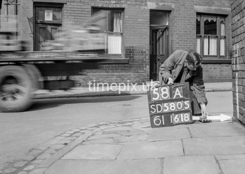 SD580558A, Man marking Ordnance Survey minor control revision point with an arrow in 1950s