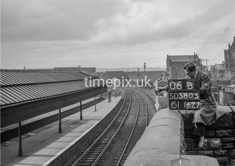 SD580506B, Man marking Ordnance Survey minor control revision point with an arrow in 1950s