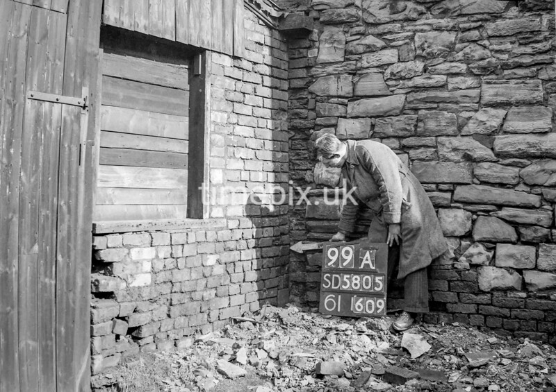 SD580599A, Man marking Ordnance Survey minor control revision point with an arrow in 1950s